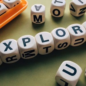 Boggle cubes lined up to spell explore